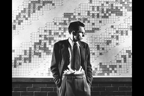 An image showing Glenn Seaborg in front of his periodic table